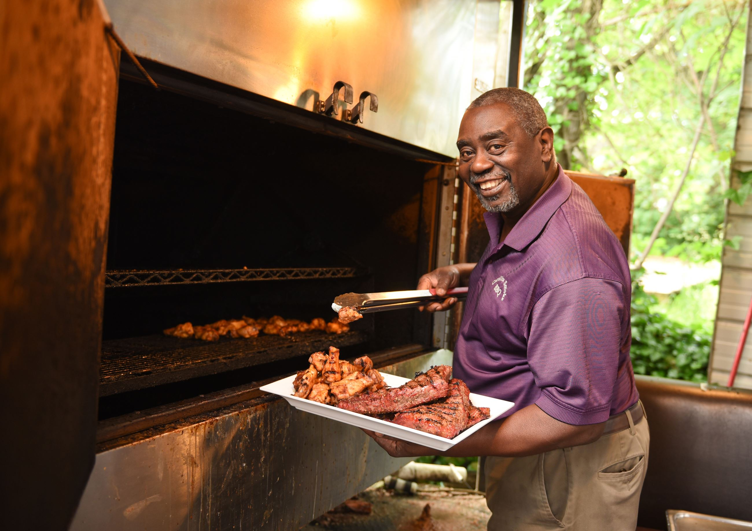 Man holding plate of bar-b-que meat