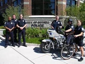 Officers Off and On Bikes Front Building