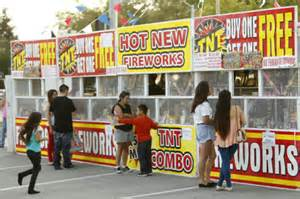 People at a fireworks stand